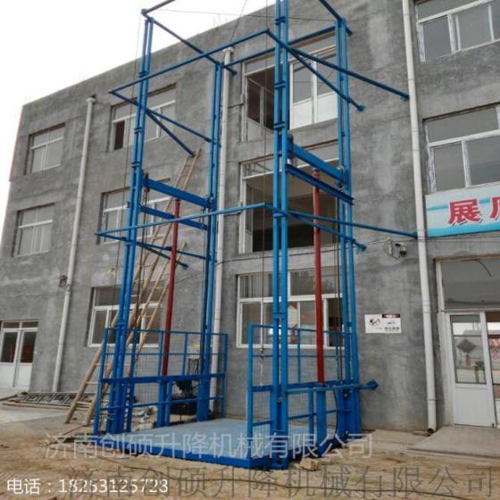 固定液压升降平台 楼层货物垂直运输导轨式链条升降机图片