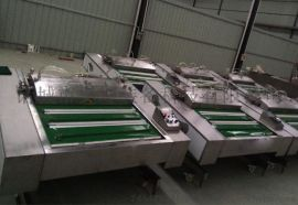 厂家直销1000酱菜包装机连续滚动真空包装机