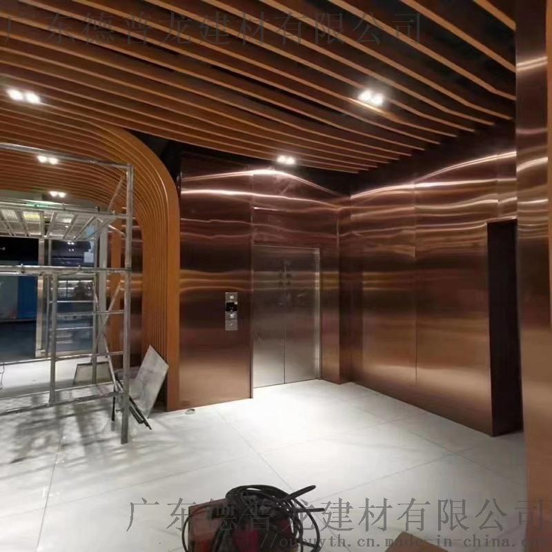 華晨茶業波浪型鋁通 過道木紋色鋁格柵幕牆造型