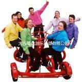 隆達7人協力腳蹬遊樂自行車