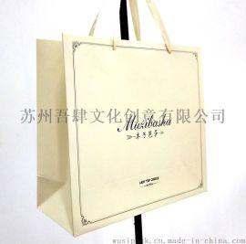 服装包装  女式大衣手提袋 白卡纸袋