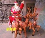 鹿拉圣诞老人车摆设  海南玻璃钢鹿拉圣诞老人车雕塑定做