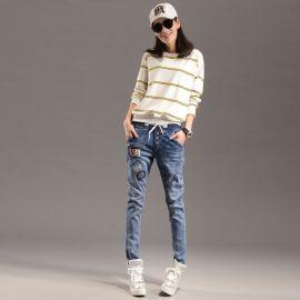 时尚女装修身牛仔裤大量库存批发