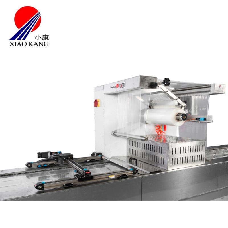 供应小康拉伸膜包装机,休闲食品连续拉伸真空包装机