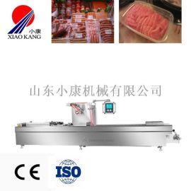520连续拉伸膜包装机,鱼豆腐连续拉伸真空包装机
