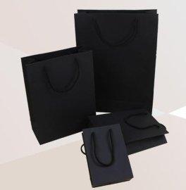 服装手提包装袋/彩印图案白卡纸包装礼品纸袋子/牛皮纸袋定做
