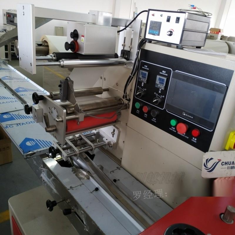 圆柱形产品包装机,保鲜膜自动包装机