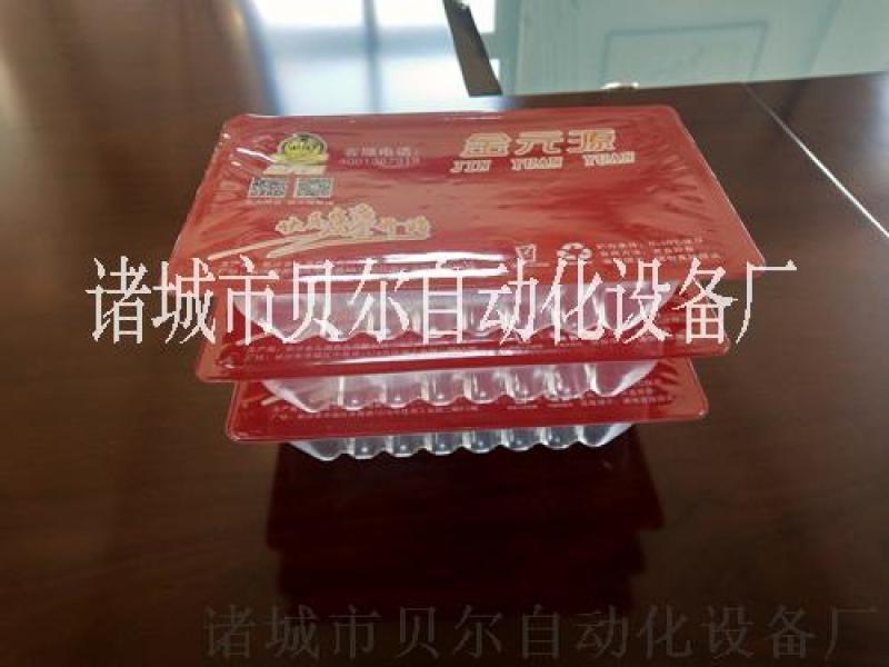 供应自动上料卤蛋抽真空包装机-每小时12000包