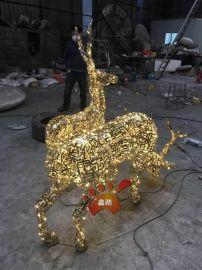 不锈钢镂空发光汉字拼接鹿雕塑灯光效果点亮城市夜景