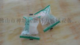 新科力-供应奶嘴包装机 奶嘴全自动枕式包装机