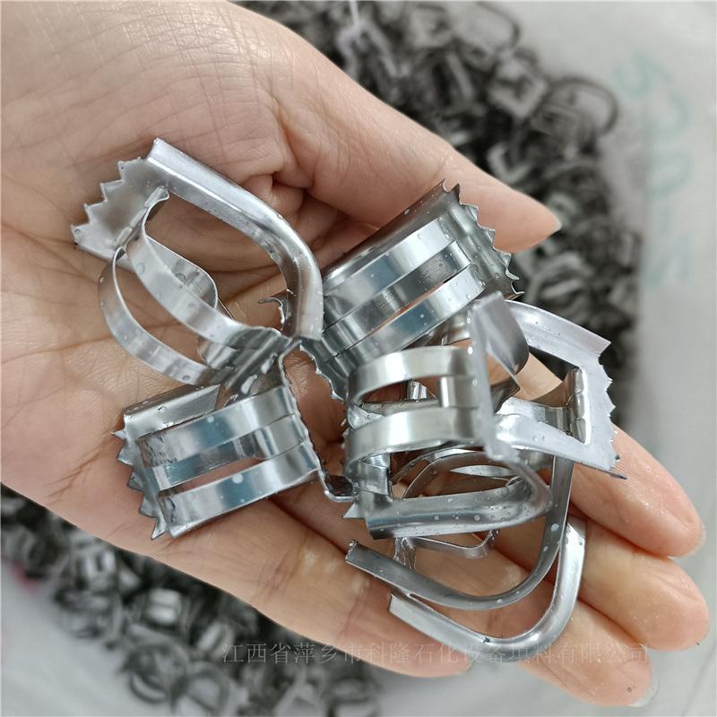今日生產DN25不鏽鋼矩鞍環316L帶齒鞍形環填料