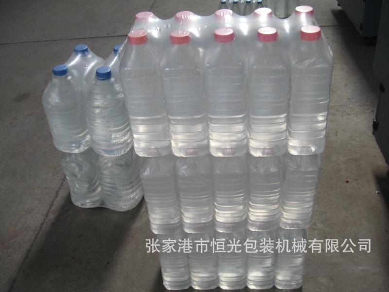 矿泉水膜包机 塑包机 热收缩包装机  直线式热收缩包装机