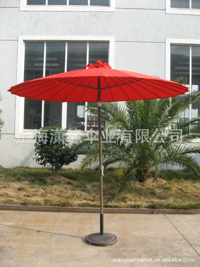 橘红色摇手钢丝伞