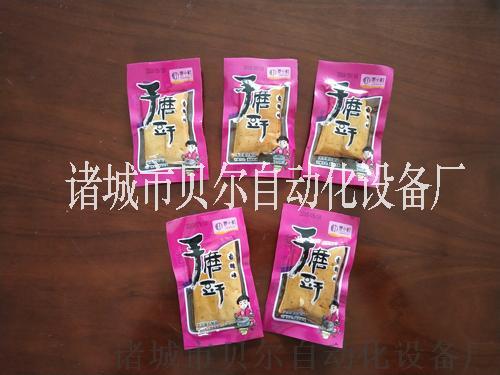 麻辣豆干自动放料全自动真空包装机设备厂家直销61223322