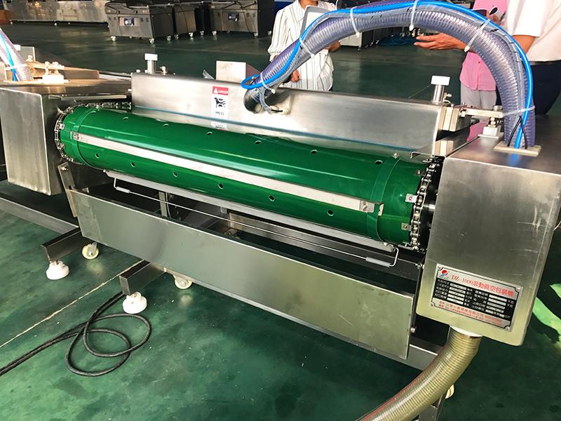 瓜子真空包装机,供应小康洽洽香瓜子滚动式真空包装机766020722